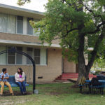 Marian Hall courtyard featuring a swing and shade trees