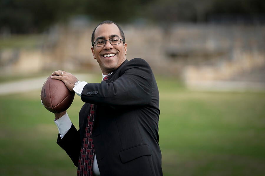 St. Mary's Law Professor David Grenardo plays with a football.