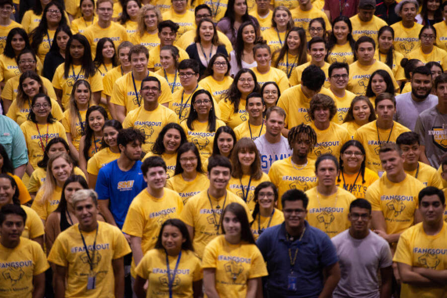 Freshmen students wear matching yellow shirts.