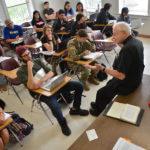 A teacher leads a theology class.