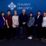 Carlos Alvarez joins students at a scholarship luncheon on March 5, 2019.