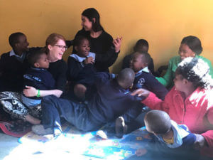Pyschology professor Jillian Pierucci, Ph.D., with children in Zambia