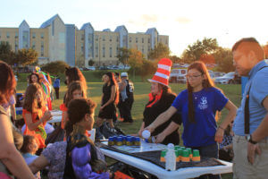 Students in costumes play games with area children at Boo Bash 2018.