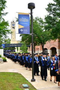 Students walk to their Commencement Ceremony in May 2019.