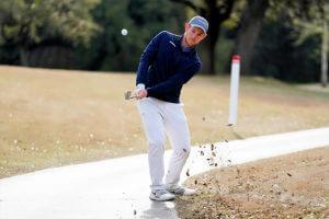 Jake Stevenson strikes a golf ball.