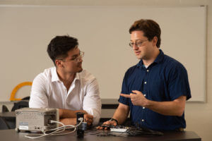 Jose Figueroa and Richard Lombardini discuss physics.