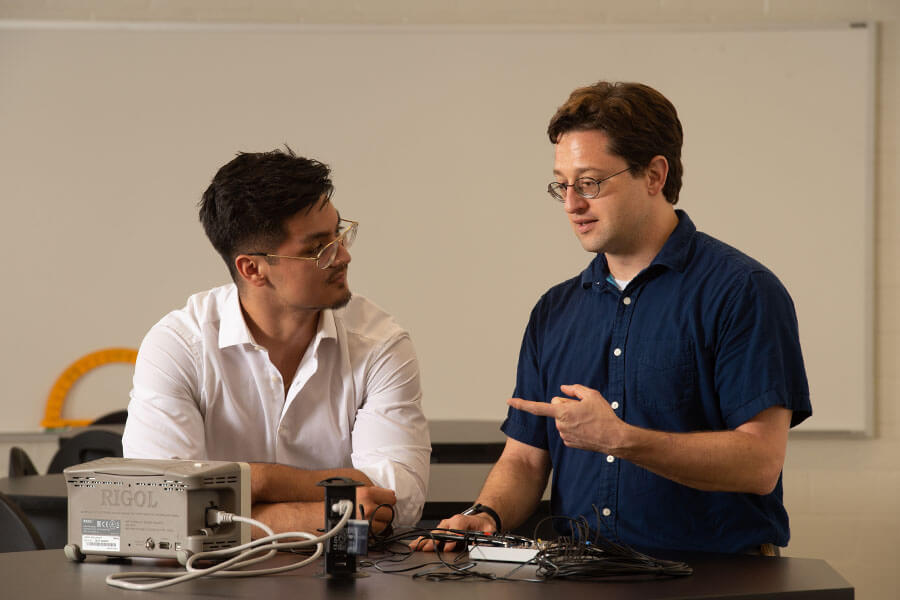 Jose Figueroa and Richard Lombardini discuss physics.