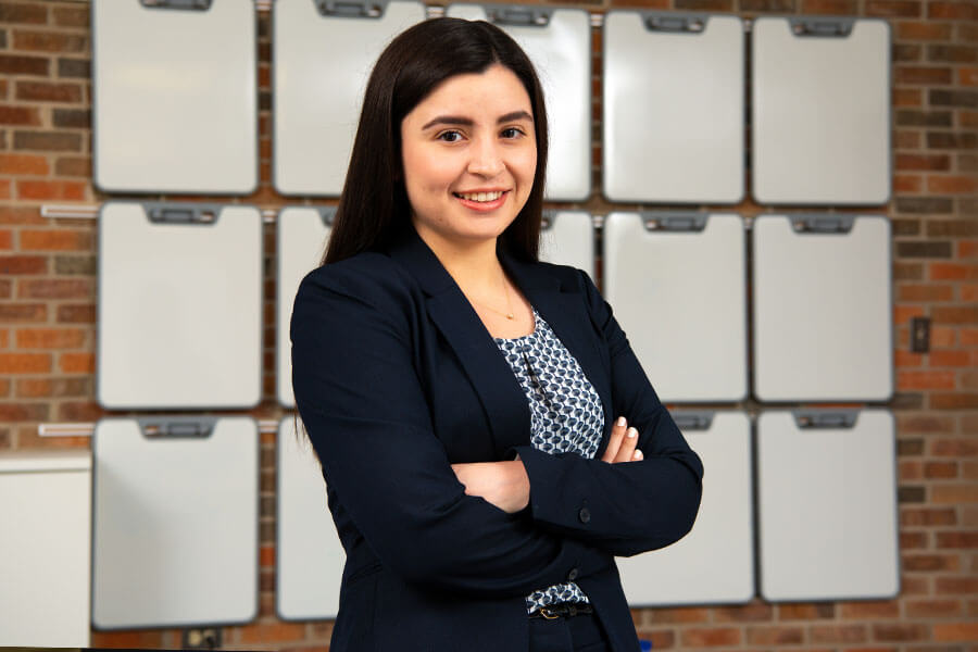 Magdalena Olivas stands in a School of Business classroom.