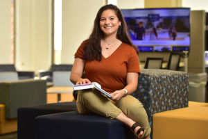 Samantha Shine Trabucco sits on the brainstorm blocks in the Graduate Center for Excellence.