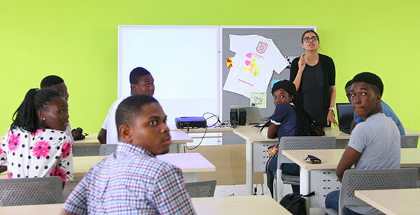 Alumna Sunitha Jenarius in a classroom