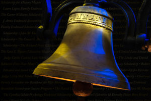 A historic St. Mary's bell is light in gold and blue.