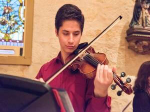 Male student playing violin
