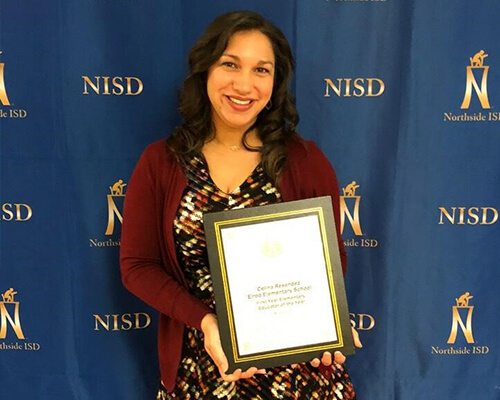 Alumna Celina receiving award for Northeast Independent School District