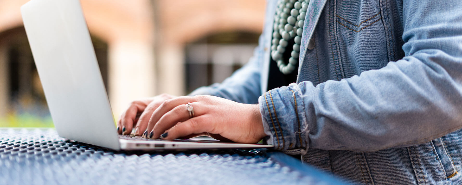 A female student types on a laptop.