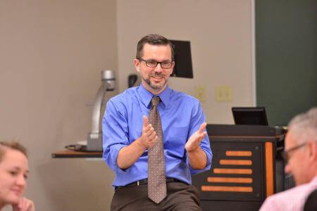 Cody Cox teaches class