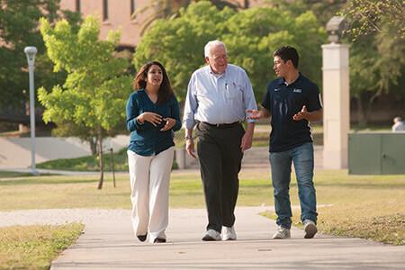 economics students walking with professor