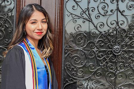Graduate in front of doors