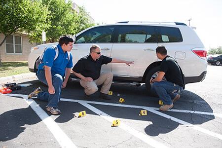 criminal justice students mock crime scene