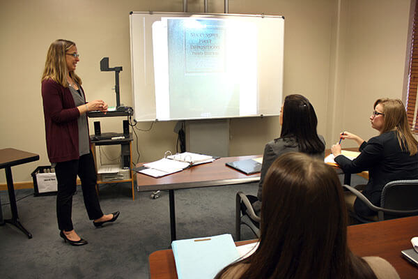 St. Mary's Clinical Professor of Law Genevieve Hébert Fajardo leads a Civil Justice Clinic class.