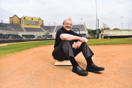 "Michael ""Mickey"" Schott (B.B.A. '68) sitting on first base"