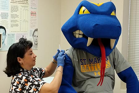 Rattler Man getting a flu shot
