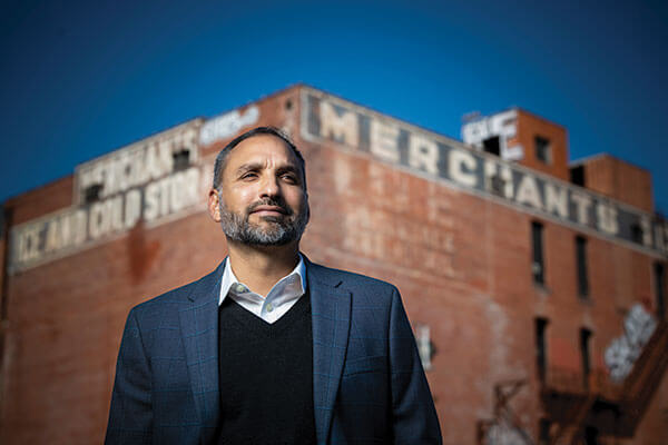 Rene Dominguez stands in front of the Merchants Ice and Cold Stage Building on East Houston Street