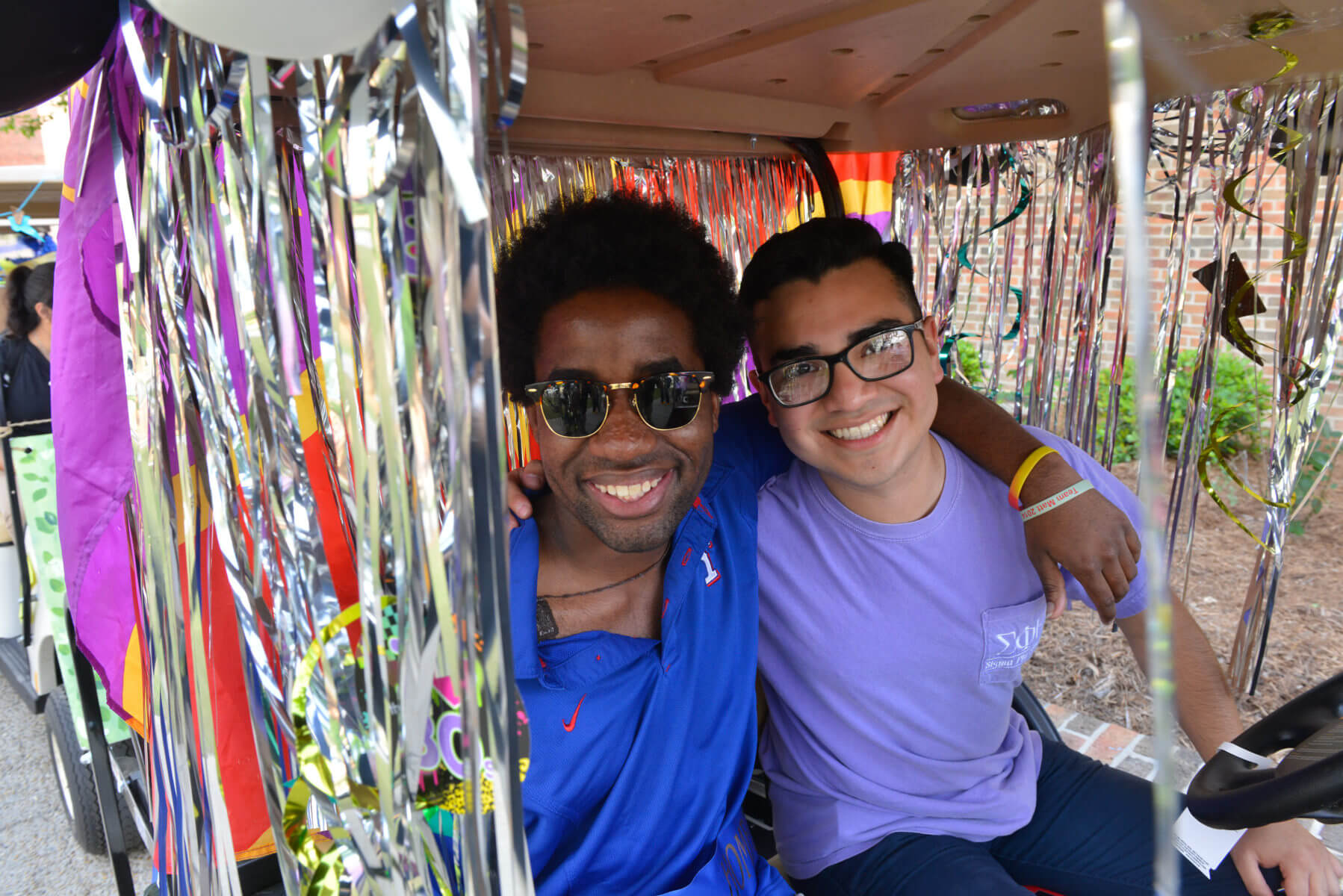 Two students pose during the golf cart parade