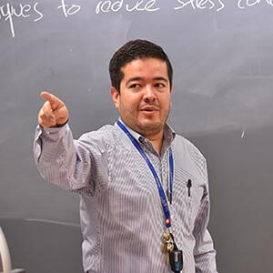 Juan Ocampo, Ph.D., instructing in class