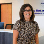 Leti Contreras of Texas Security General Insurance agency stands in her company for a photo.