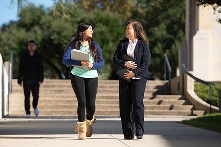 Angeli Willson and student walking