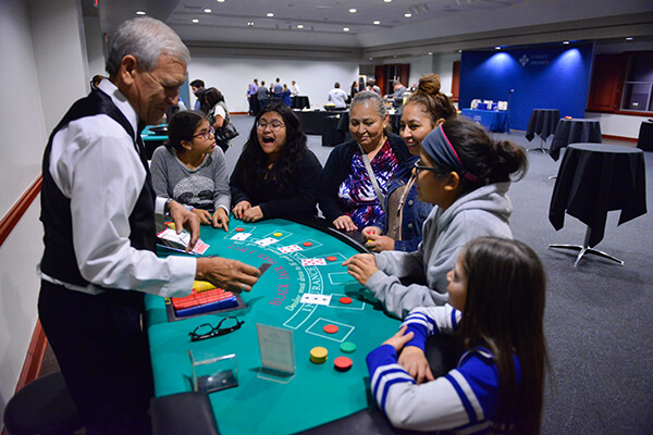 A student and their family play a game at Casino Night