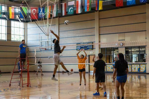 Students play in an intramural volleyball game