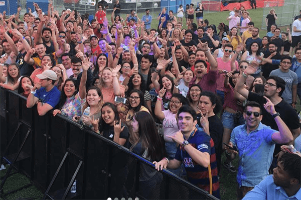 Students crowd around a stage during Rattler Fest