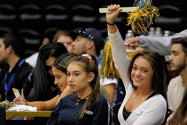 A fan cheers on the Rattlers at Rattler Madness