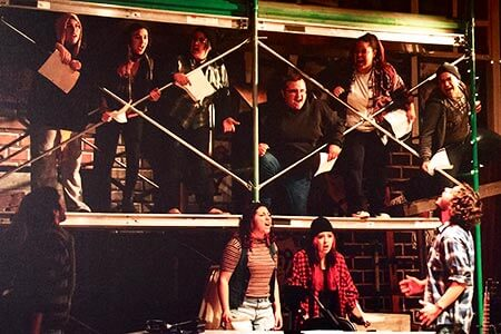A group of theatre students performing Rent the Musical