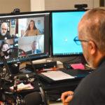 A.J. Bellido de Luna looks at a Zoom screen on his computer.