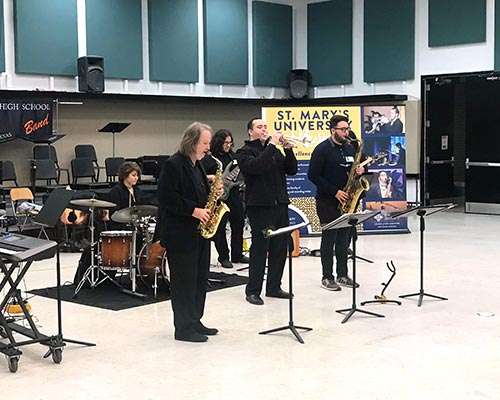 five musicians playing in the jazz combo