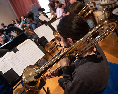 close up of music student playing the trombone