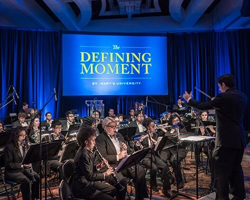 wind ensemble performing at St. Mary's Defining Moment event
