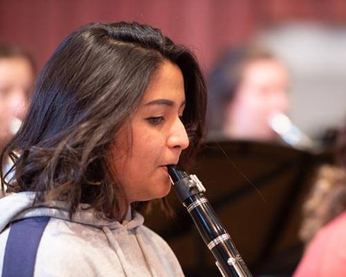 student playing the clarinet during rehearsal