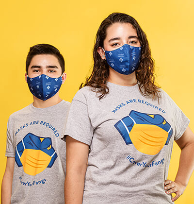 Two students wear masks to show COVID-19 safety.