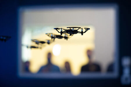 Four drones fly simultaneously in the new Drone Lab.