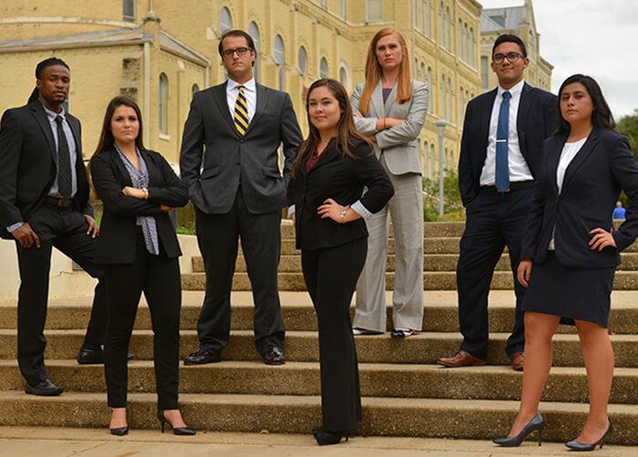 Greehey Scholars posing on stairs
