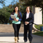 Professor Angeli Willson walks with a female student featured
