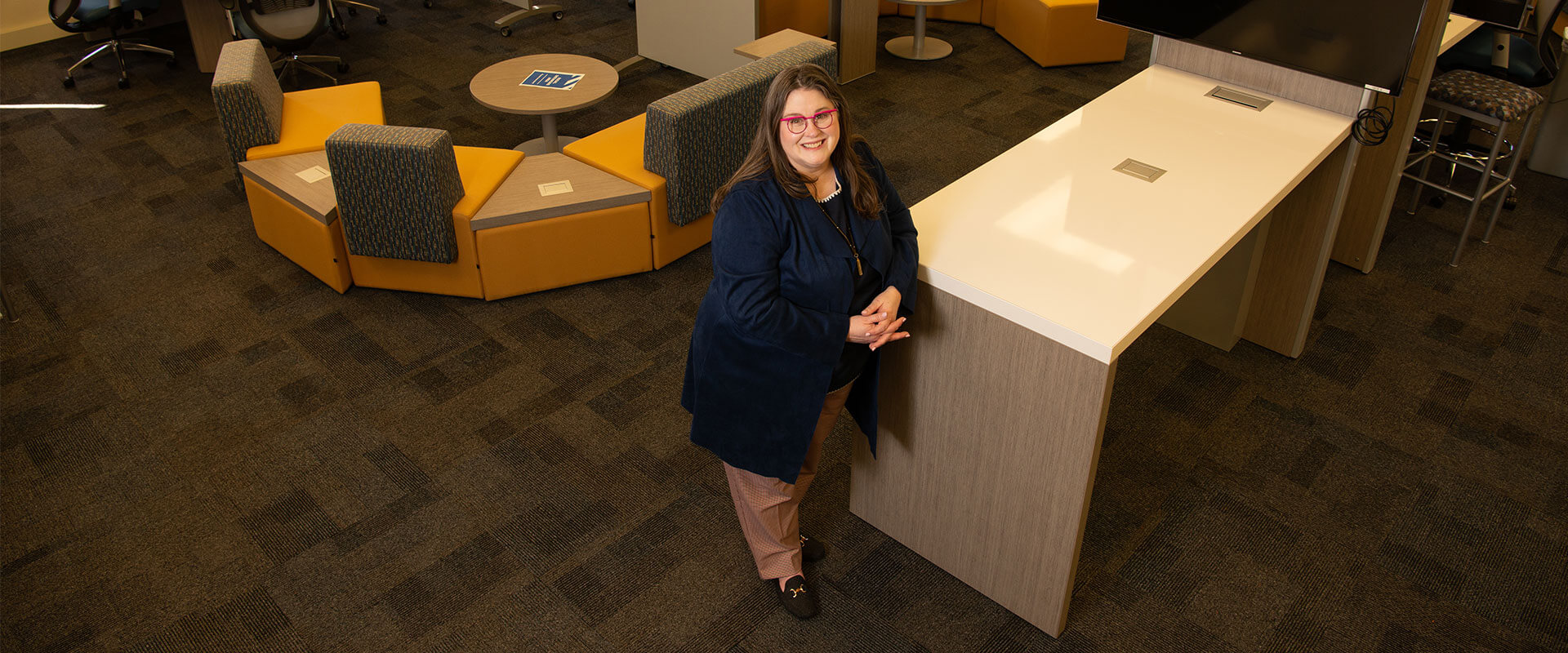 Kathe Lehman-Meyer stands in the Graduate Center for Excellence.