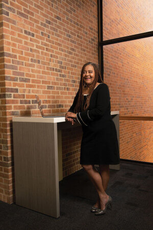 Laura Thompson stands in the Graduate Center for Excellence.