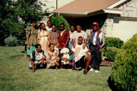 Jeddidah Thotho with then-Professor of English Elijah Akhahenda and his family.