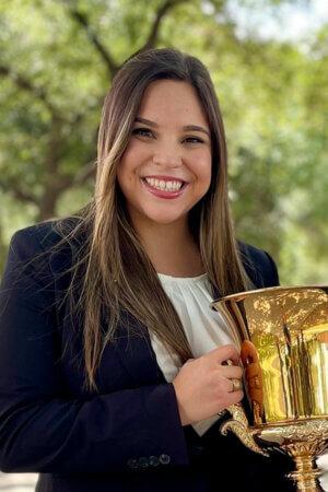 J.D. student Kathryn Cantu holds the David & Linda Schlueter 1L Moot Court trophy